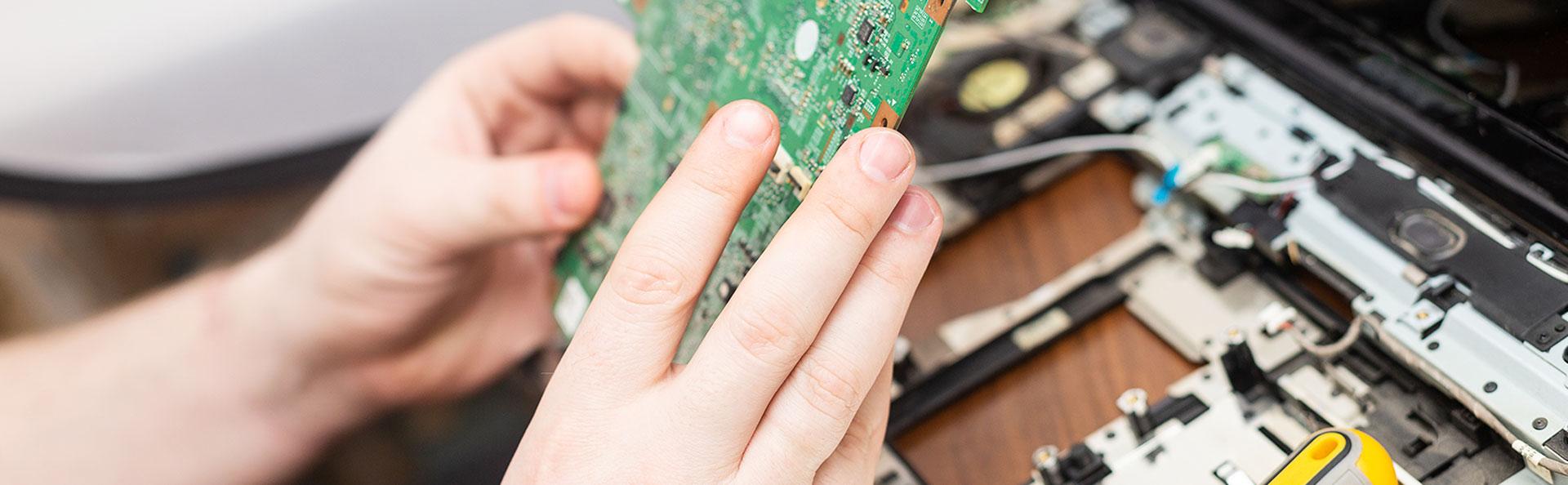 Mitchell PC Repair technician repairing hardware issues.